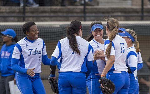 Group of TU Girls Softball Team players in a huddle