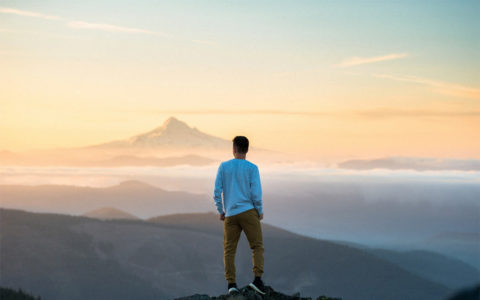 man standing on top of mountain - inspirational