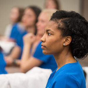 student nurses listen attentively to a lecture
