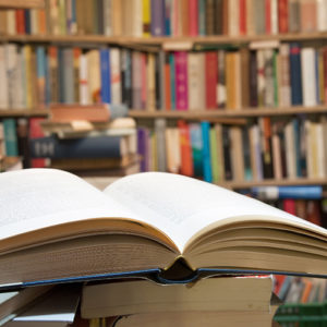 close up image of an open book in a library