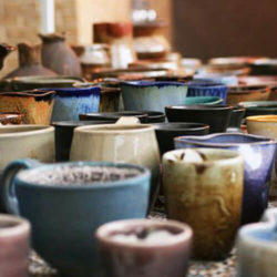 a beautiful array of pottery sits on the table of the ceramics studio in Phillips Hall