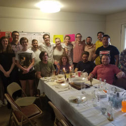 Hillel students celebrating a special jewish holiday (Passover) together around a dinner table.