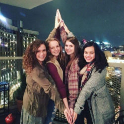 Kappa Alpha Theta members take a diamond picture on a balcony