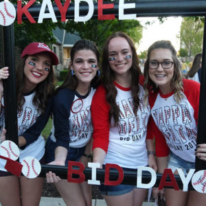 Kappa Delta members smile with their new members on Bid Day