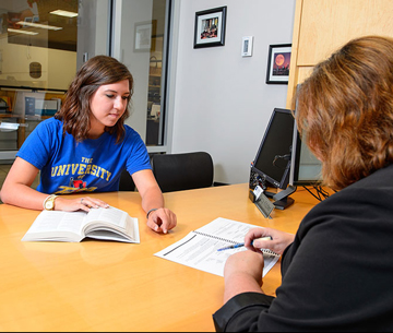 a career adviser assists a student