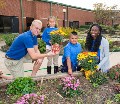 Students help plant flowers in Kendall Whittier garden