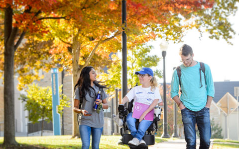 students move across campus in the fall