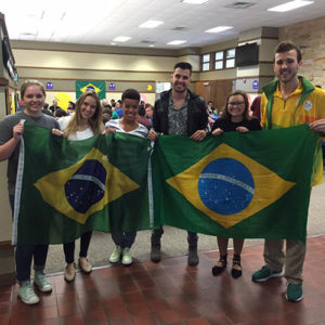 Brazil Club members holding up the Brazilian flag together during an annual celebration on TU's campus of Brazil's Independence Day.