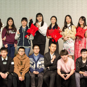 Chinese Student Association members pose together in a group photo.