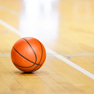 close up view of a basketball sitting on a basketball court