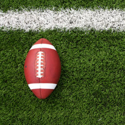 a football sitting on a field