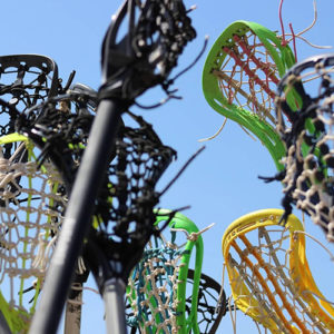 A close up view of lacrosse sticks outside on a sunny day