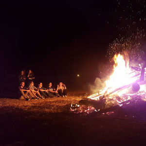 TU Treks have a fun evening together sitting around a bonfire talking