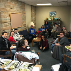 Students and faculty enjoying good food and conversation in spanish during a Tertulia meeting.