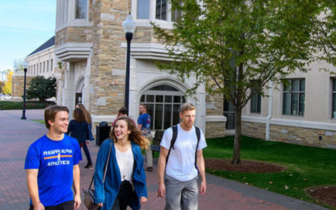 Students walk outside of Rayzor Hall