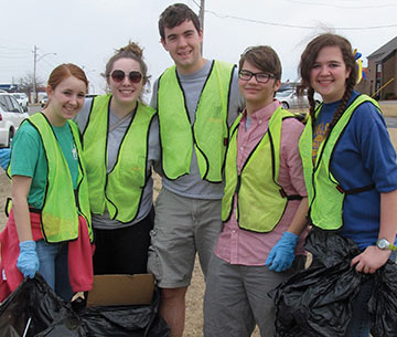 students pick up trash for the community