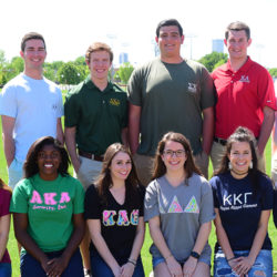 TU greek life students pose together in a group with a representative from each house