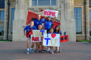Students wave welcome banners for class of 2023