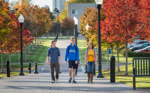 students walking on campus with fall colors