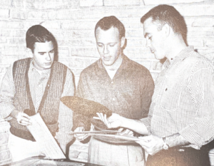 Pi Kappa Alpha brothers play records in 1959.