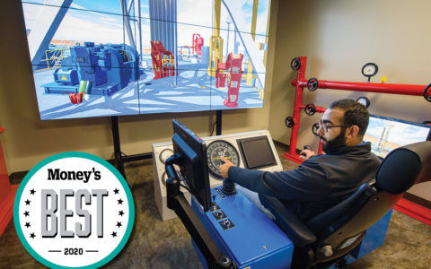 young man sitting at the controls of an engineering simulation machine