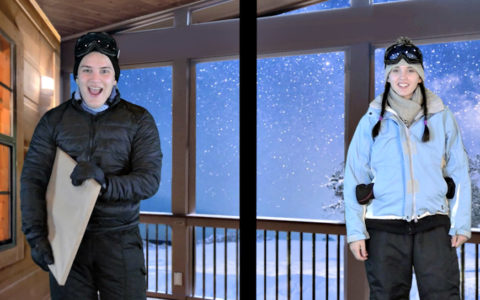 A male and a female actor standing against a snowy nighttime backdrop