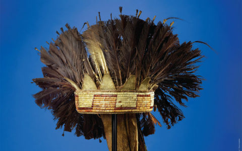 a feathered Choctaw headdress set against a blue background