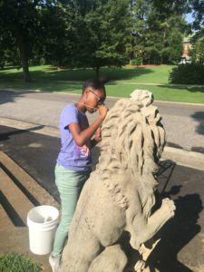 Girl cleaning a statue