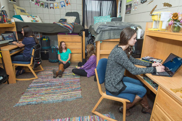 Housing students in a dorm